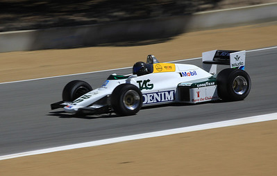 Danny Baker drives a 1983 Williams FW-08C Formula 1 racer toward turn 9.