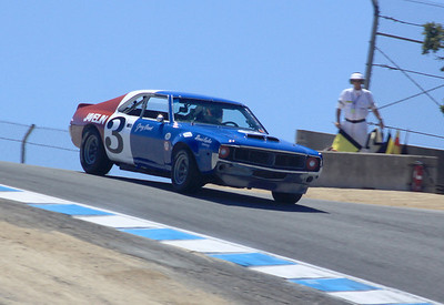 A 1969 AMC Javeling driven by Craig Jackson races through the Corkscrew.