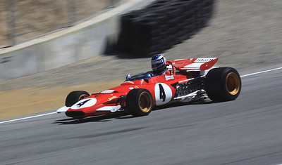 A classic 1970 Ferrari 312B Formula 1 racer heads downhill in the Corkscrew.
