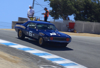 A 1968 Camaro Z/28 driven by Tom McIntyre negotiates the Corkscrew.