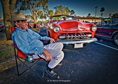 Friday, March 23, 2012. Wellington Car Show. Red in front of his '54 Chevy.