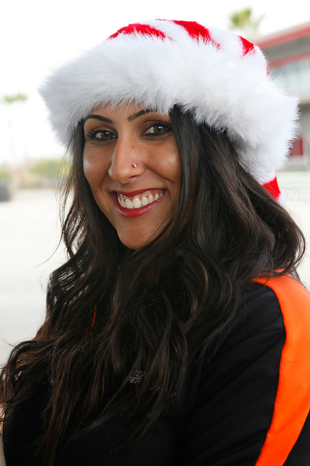 Xtreme Xperience elf Alisha Ahuja gets into the holiday spirit before the motorcade. (Bradley S. Pines / Xtreme Xperience)