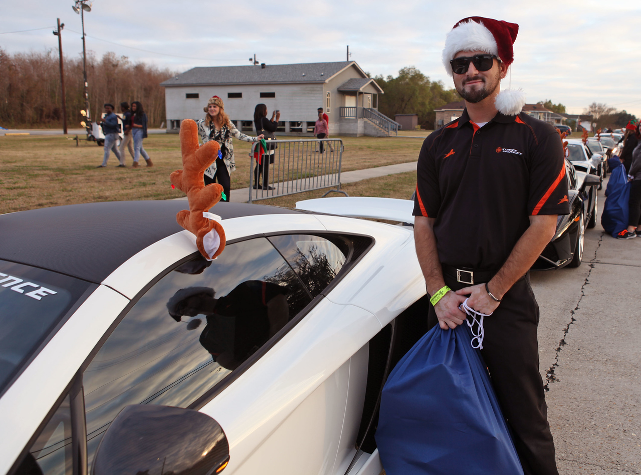 Xtreme Xperience elf Ted Tragas brought gifts in the XX McLaren MP4-12C.  (Bradley S. Pines / Xtreme Xperience)