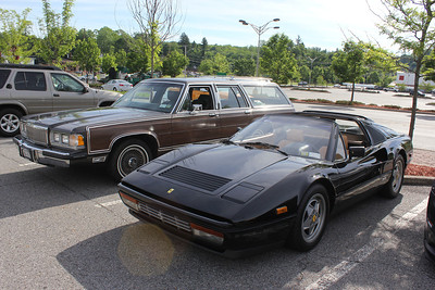 Ferrari 328 GTS and Mercury Grand Marquis