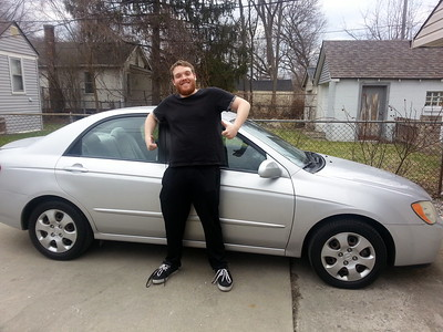 Scott with his 2014 Kia Spectra - purchased in April 2014. Pictured at the house Scott and Brad were renting in Royal Oak.