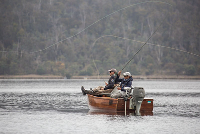 Anglers fly fishing for trout in Tasmania's Four Springs Lake.
