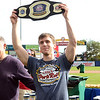 Carmen Cincotti holds up the winners belt  after he won the Trenton Thunder Case`s Pork Roll Eating Championship on Saturday at Arm&Hammer Park. Cincotti consumed  40 pork roll sandwichs in 10 minutes. World Champion Joey Chestnut did not attend the event. gregg slaboda photo