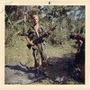 WC-6 Thomas Burnside (TX) of 1st Platoon, in the boonies with an M-60 machinegun and an unidentified grunt.
