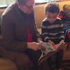 Grandma and Cash reading a book