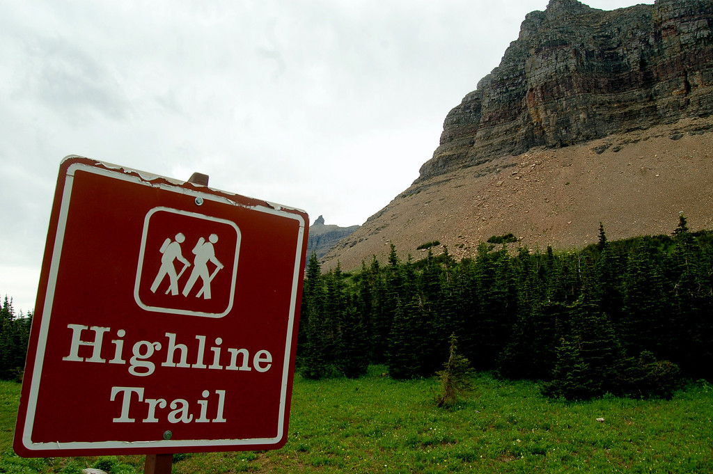 """Highline Trail From Logan Pass Along the Garden Wall<br /> <br /> """"Few places in the world are more deadly than home. Fear not, therefore, to try the mountain passes. They kill care, save you from deadly apathy, and call forth every faculty, into vigorous, enthusiastic, action."""" John Muir<br /> <br /> My arrival at Many Glacier Campground by chance coincides with the first time in several of the Rangers memory that 3 of the 4 major trails from the area are closed due to bear activity. <br /> <br /> One of the incidents that was associated with the trail closing occurred when Jack Hanna, the noted zookeeper who appears occasionally on the Letterman show, had to use his bear spray on a cub that was advancing on him in the Many Glacier area. <br /> <br /> I suspect another reason for all the closings is the result of another recent incident near Yellowstone National Park in which one camper was killed and two wounded when a grizzly attacked their campground at night.<br /> <br /> As a result of all of the trail closings in the Many Glacier area, I chose to take John Muir's advice and explore the mountain passes near Logan Pass via the Highline Trail. The Garden Wall trail traverses the Continental divide above timberline with stunning views in all directions. The trail also leads to historic Granite Park Chalet located in Glacier's wilderness. I left my truck at Logan Pass to begin the journey. <br /> <br /> The hike proved to be the most enriching photographic opportunity I have ever experienced. I shot hundreds of photos of sweeping mountain scenery, wildflowers, waterfals, deer, mountain goats, bighorn sheep, ptarmigan, picas, and marmots and thankfully, no grizzly bears. My family and friends will tell you that they have heard a story too often from me about the time I was hiking Gunsite Pass going up some switchbacks when a goat and her kid appeared before me. She stared at me until I pasted myself against the mountain on the trail. They both passed by me within i"""