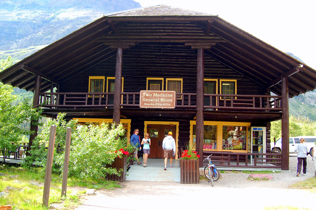 "This store was formerly one of the Chalets located throughout the Park that was converted to the store. The original Chalet was the site of the fire fireside chat from a president (Franklin Roosevelt) in a National Park..<br /> <br /> <br /> Franklin D. Roosevelt: ""Radio Address from Two Medicine Chalet, Glacier National Park.,"" August 5, 1934.<br /> <br /> ""I have been back on the soil of the continental United States for three days after most interesting visits to our fellow Americans in Puerto Rico, the Virgin Islands, the Canal Zone and the Territory of Hawaii. I return with the conviction that their problems are essentially similar to those of us who live on the mainland and, furthermore, that they are enthusiastically doing their part to improve their conditions of life and thereby the conditions of life of all Americans.<br /> <br /> On Friday and Saturday I had the opportunity of seeing the actual construction work under way in the first two national projects for the development of the Columbia River Basin. At Bonneville, Oregon, a great dam, 140 miles inland, at the last place where the river leaps down over rapids to sea level, will provide not only a large development of cheap power but also will enable vessels to proceed another 70 or 80 miles into the interior of the country.<br /> <br /> At Grand Coulee, in North Central Washington, an even greater dam will regulate the flow of the Columbia River, developing power and, in the future, will open up a large tract of parched land for the benefit of this and future generations. Many families in the days to come, I am confident, will thank us of this generation for providing small farms on which they will at least be able to make an honest and honorable livelihood.<br /> <br /> Today, for the first time in my life, I have seen Glacier Park. Perhaps I can best express to you my thrill and delight by saying that I wish every American, old and young, could have been with me today. The great mountains, the glaciers, the lakes and the trees make me long to stay here for all the rest of the summer.<br /> <br /> Comparisons are generally objectionable and yet it is not unkind to say, from the standpoint of scenery alone, that if many, and indeed most, of our American national parks were to be set down anywhere on the continent of Europe thousands of Americans would journey all the way across the ocean in order to see their beauties.<br /> <br /> There is nothing so American as our national parks. The scenery and wild life are native. The fundamental idea behind the parks is native. It is, in brief, that the country belongs to the people, that it is in the process of making for the enrichment of the lives of all of us. The parks stand as the outward symbol of this great human principle.<br /> <br /> It was on a famous night, sixty-four years ago, that a group of men who had been exploring the Yellowstone country gathered about a campfire to discuss what could be done with that wonderland of beauty. It is said that one of the party, a lawyer from the State of Montana, Cornelius Hedges, advanced the idea that the region might be preserved for all time as a national park for the benefit of all the people of the Nation. As a result of that suggestion, Yellowstone National Park was established in 1872 by Act of Congress as a ""pleasuring ground"" for the people. I like that phrase because, in the years that have followed, our great series of parks in every part of the Union have become indeed a ""pleasuring ground"" for millions of Americans.<br /> <br /> My old friend, Franklin K. Lane, Secretary of the Interior in the Wilson Administration, well described the policies governing the National Park Administration when he said:<br /> <br /> ""The policy to which the Service will adhere is based on three broad principles: First, that the national parks must be maintained in absolutely unimpaired form for the use of future generations as well as those of our own time; second, that they are set apart for the use, observation, health and pleasure of the people; and, third, that the national interest must dictate all decisions affecting public or private enterprise in the parks.""<br /> <br /> The present National Park Service stands as an example of efficient and far-seeing governmental administration and to its former duties I added last year by transferring from other departments many other parks, battlefield sites, memorials and national monuments. This concentration of responsibility has thus made it possible to embark on a permanent park policy as a great recreational and educational project—one which no other country in the world has ever undertaken in such a broad way for protection of its natural and historic treasures and for the enjoyment of them by vast numbers of people. Today I have seen some of the work of the Civilian Conservation Corps boys in this Northwestern country. Of the three hundred thousand young men in these Camps, 75,000 are at work in our national parks. Here, under trained leadership, we are helping these men to help themselves and their families and at the same time we are making the parks more available and more useful for the average citizen. Hundreds of miles of firebreaks have been built, fire hazards have been reduced on great tracts of timberland, thousands of miles of roadside have been cleared, 2,500 miles of trails have been constructed and 10,000 acres have been reforested. Other tens of thousands of acres have been treated for tree disease and soil erosion. This is but another example of our efforts to build not for today alone, but for tomorrow as well.<br /> <br /> We should remember that the development of our national park system over a period of many years has not been a simple bed of roses. As is the case in the long fight for the preservation of national forests and water power and mineral deposits and other national possessions, it has been a long and fierce fight against many private interests which were entrenched in political and economic power. So, too, it has been a constant struggle to continue to protect the public interest, once it was saved from private exploitation at the hands of the selfish few.<br /> <br /> It took a bitter struggle to teach the country at large that our national resources are not inexhaustible and that, when public domain is stolen, a twofold injury is done, for it is a theft of the treasure of the present and at the same time bars the road of opportunity to the future.<br /> <br /> We have won the greater part of the fight to obtain and to retain these great public park properties for the benefit of the public. We are at the threshold of an even more important battle to save our resources of agriculture and industry from the selfishness of individuals.<br /> <br /> The Secretary of the Interior in 1933 announced that this year of 1934 was to be emphasized as ""National Parks Year."" I am glad to say that there has been a magnificent response and that the number visiting our national parks has shown a splendid increase. But I decided today that every year ought to be ""National Parks Year."" That is why, with all the earnestness at my command, I express to you the hope that each and every one of you who can possibly find the means and opportunity for so doing will visit our national parks and use them as they are intended to be used. They are not for the rich alone. Camping is free, the sanitation is excellent. You will find them in every part of the Union. You will find glorious scenery of every character; you will find every climate; you will perform the double function of enjoying much and learning much.<br /> <br /> We are definitely in an era of building, the best kind of building-the building of great public projects for the benefit of the public and with the definite objective of building human happiness.<br /> <br /> I believe, too, that we are building a better comprehension of our national needs. People understand, as never before, the splendid public purpose that underlies the development of great power sites, the improving of navigation, the prevention of floods and of the erosion of our agricultural fields, the prevention of forest fires, the diversification of farming and the distribution of industry. We know, more and more, that the East has a stake in the West and the West has a stake in the East, that the Nation must and shall be considered as a whole and not as an aggregation of disjointed groups.<br /> <br /> May we come better to know every part of our great heritage in the days to come."""