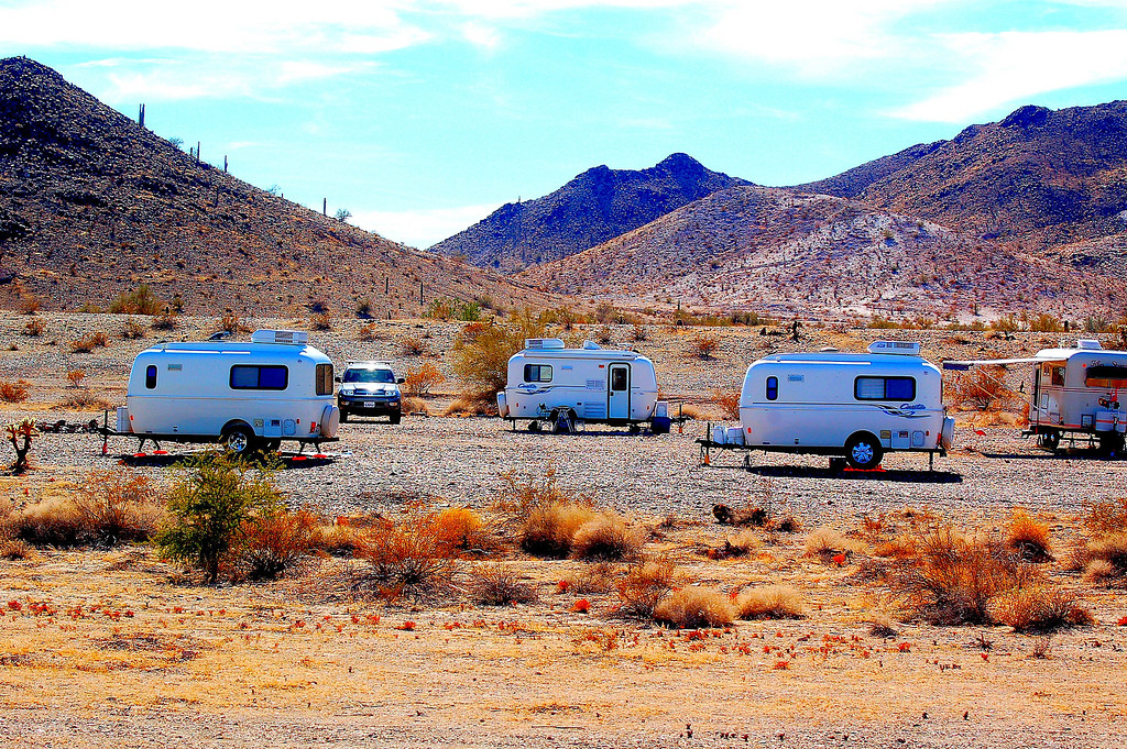 Casita gathering camped nearby in classic wagon train formation.