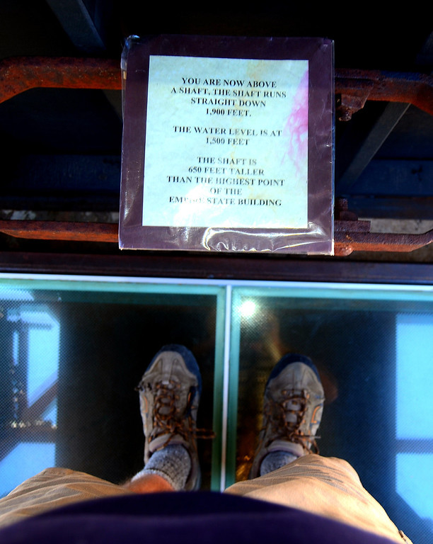 I am standing on a glass cover over the mine shaft that decends some 1,900 feet below.