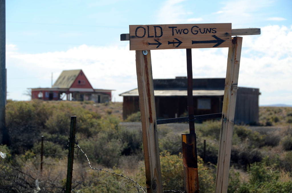 """EFFORTS TO REVITALIZE DREAMS<br /> <br /> """"It was a classic Route 66 tourist attraction, one of the earliest ones,"""" Mangum said of Two Guns. """"They used the signs and all the gaudy attractions to get people to turn off road and to have a chance to sell them something.""""<br /> <br /> Ben Dreher bought the property in the 1960s and tried to make a go of it, until a fire destroyed his business in 1971.<br /> <br /> """"It ended in a ball of fire,"""" Mangum said. """"A huge fire leveled almost all of the modern stuff. Then the freeway came in, and they tried to take advantage of it. It's had a succession of owners who've tried to pump money into it and turn it into a first-class attraction, and it isn't working.""""<br /> <br /> Even though it got an official highway exit, Two Guns went into decline with the building of Interstate 40 in the 1970s.<br /> <br /> In 1992, Howard Armstrong, a major player in Quartzite attractions, bought the property and was the last owner to try his hand at Two Guns. He saw it as a natural tourist attraction, with no other developments around it for miles. His efforts came to naught. In 1995, he had a stroke, continuing the bad luck tradition of the place.<br /> <br /> Two Guns may yet have the last laugh. Currently for sale, it awaits an owner with vision to come along and breath life into this Route 66 dream."""