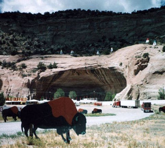"""Legal troubles for Miller forced him to move from Two Guns. He reopened the zoo on Route 66 at this site in 1931 and true to form added some fake Indian dwellings.. He called it the Cave of the Seven Devils. You know it today as  Fort Chief Yellowhorse.<br /> <br /> <br /> """"Route 66 travelers know Chief Yellowhorse land and trading post is bordered by Route 66 and is the first place you see as you enter Arizona from New Mexico along the base of red cliffs. The state border runs right through the hogan he built many years ago and serves as the entrance to his trading post."""""""