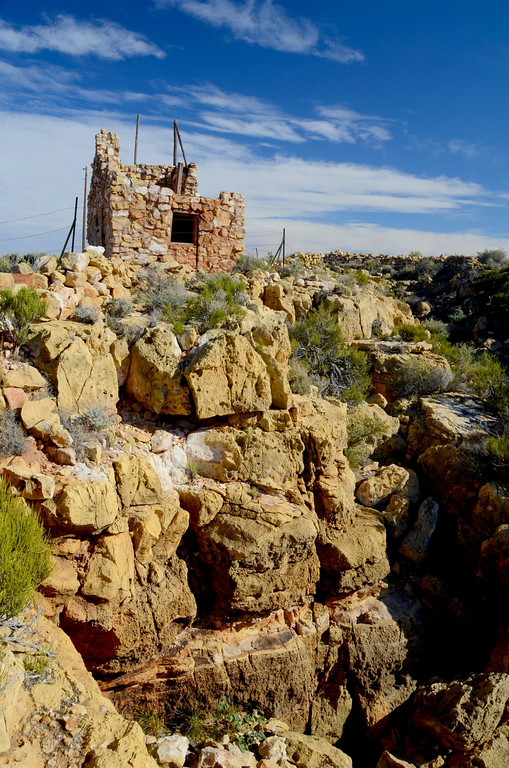 """""""Hired by Harry """"Indian"""" Miller, local Hopi built this pueblo structure in the 1920s at the edge of Canyon Diablo. It overlooks the arm of the gorge that leads into the Apache Death Cave, which Miller turned into a tourist attraction.""""<br /> <br /> """"Though it looks to be in ruins, the pueblo appears almost exactly as it did nearly a century ago, having been designed to appear as one of several """"ancient"""" cliff dwellings, which Miller added to draw tourists."""