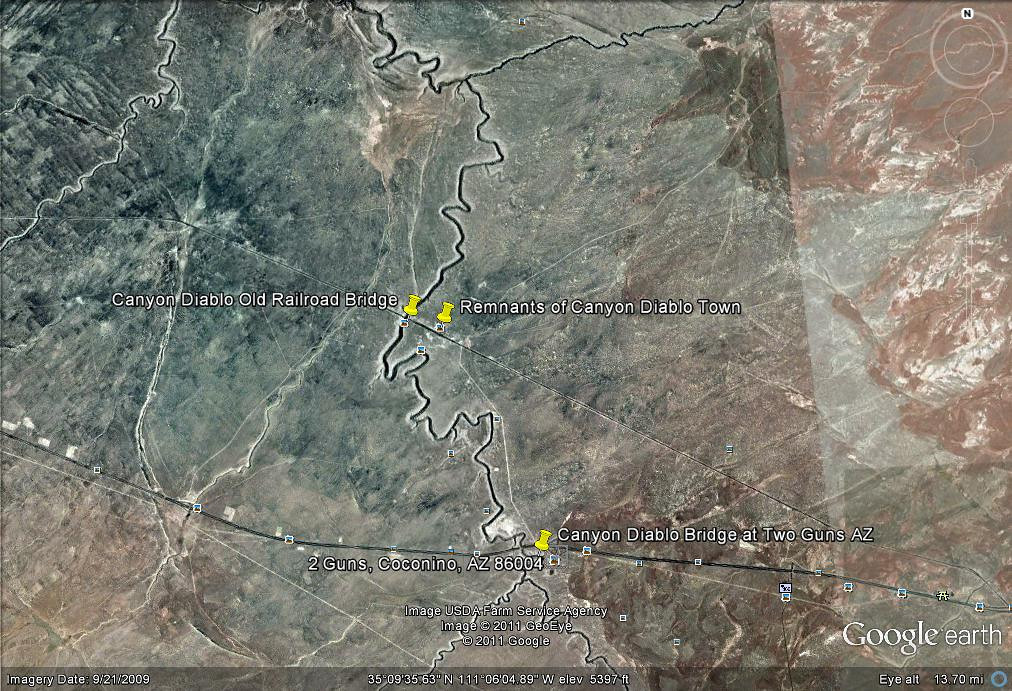 I made this Google Earth map for a  view of I-40 Exit 230 area. Just north of Two Guns, Az and accessible by 4 wheel drive is the old railroad bridge and the remnants of Canyon Diablo, a ghost town now, but once one of the wickedest towns in all the West.<br /> <br /> In the past, meteorites rich in platinum and nickle were found and carted out of this area. Meteor Crater is nearby Two Guns. A sheepherder once found an old silver bar believed to be left behind by Spanish explorers was found in the area. Gold coins were found in the area where the town of Canyon Diablo once existed. Monies from a robbery in Winslow are believed to have been hidden in Diablo Canyon near Two Guns. The robbers were captured or killed in a shootout nearby.