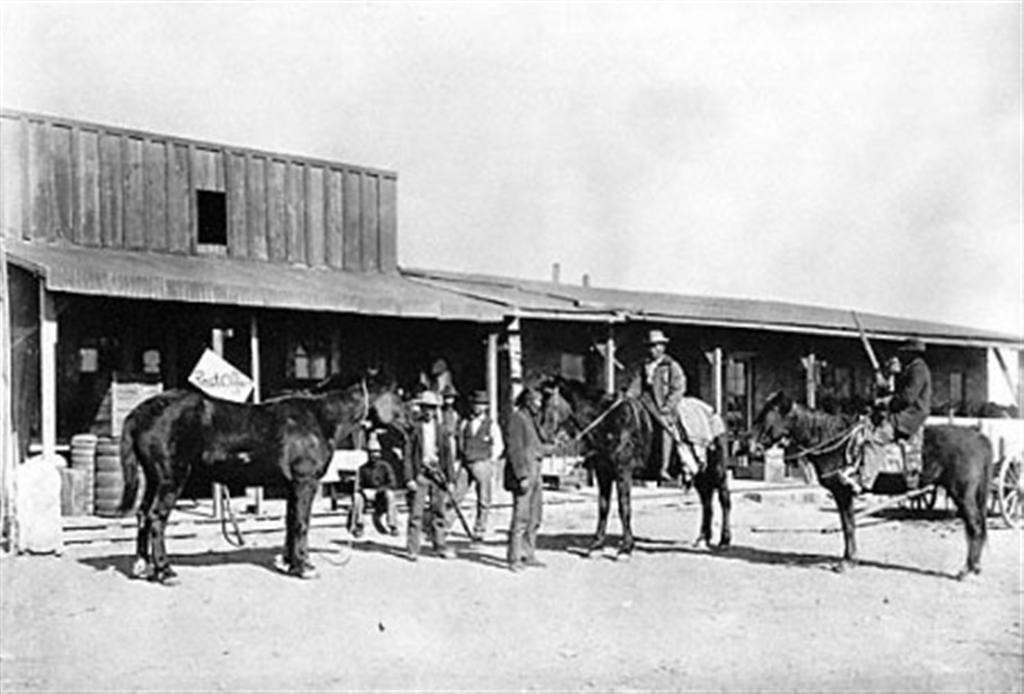 """There being no law enforcement in the settlement, it quickly became a wild and lawless place as drifters, gamblers, and outlaws made their way to town. <br /> <br /> With the closest law enforcement being some 100 miles away, the settlement earned a reputation of being meaner than Tombstone and Dodge City combined, with many of it ""citizens"" winding up in the local cemetery.<br /> <br /> The saloons, gambling dens and brothels never closed, running 24 hours a day. The town comprised mostly of shacks with two lines of buildings facing each other across the rocky road on the north side of the railroad right-of-way. The ""street,"" aptly referred to as Hell Street, included fourteen saloons, ten gambling houses, four brothels and two dance halls. Wedged between these businesses  were a couple of eating counters, a grocery and a dry goods store.<br /> <br /> With a population of nearly 2,000, a regular stage operated between Flagstaff and Canyon Diablo that ended up being the target of many robberies. When Canyon Diablo finally got a peace officer, the first one pinned on a badge at 3:00 p.m. and was laid out for burial at 8:00 p.m. Five more foolish men also tried their hands at marshalling in this God forsaken town. None of them lasted more than a month in the position before they too were killed.<br /> <br /> Boot Hill cemetery filled up fast, where at one time 35 graves could be seen with wooden markers and stone covered mounds. All are gone today, but that of Herman Wolf, a trader who passed away in 1899 and the only one to have died peacefully.<br /> <br /> Once the railroad bridge was built over the canyon, the town began to die. Still wild, the remaining residents requested that the army take over law enforcement, but before they arrived the town was pretty much dried up and the lawless drifters had moved on."""