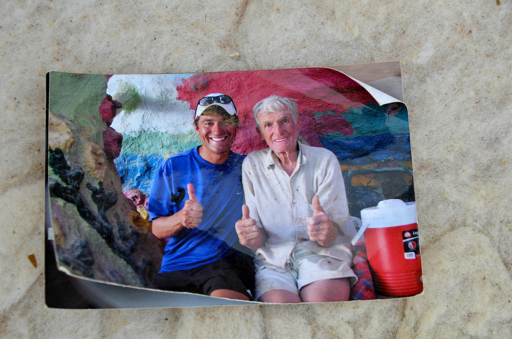 """Picture of Leonard with a fan found tucked in sofa outside his truck.<br /> <br /> Photos of Salvation Mountain by National Geographic photographer Aaron Huey:<br /> <br />  <a href=""""http://www.aaronhuey.com/#/editorial-archive/salvation-mountain/salvation_mountain_018"""">http://www.aaronhuey.com/#/editorial-archive/salvation-mountain/salvation_mountain_018</a>"""