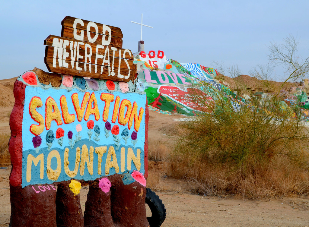 """For some 25 years Leonard Knight worked on his Salvation Mountain project. His message was simple, God is love. Salvation Mountain is located near Niland, California at the entrance to Slab City.<br /> <br /> Leonard was placed in a care home in Dec of 2011 and the future of Salvation Mountain is unknown. In a tragic coincidence, Leonard's assistant and caregiver for the last several years, Kevin Eubank, died in his sleep several days after Leonard was placed in the care home. <br /> <br /> Leonard's clothes and personal belongings still reside in the old truck he slept in for years at the site. It was a little disappointing not to meet Leonard as so many have, but his creation survives for now at least.<br /> <br /> Update: 3/1/12 """" Salvation Mountain is missing its guiding spirit""""  <br /> <br />  <a href=""""http://www.latimes.com/news/local/la-me-salvation-20120226"""">http://www.latimes.com/news/local/la-me-salvation-20120226</a>,0,4744945.story (cut and paste url to browser)<br /> <br /> """"Salvation Mountain's fate undetermined:""""<br /> <br />  <a href=""""http://articles.ivpressonline.com/2011-12-28/kevin-eubanks_30567134"""">http://articles.ivpressonline.com/2011-12-28/kevin-eubanks_30567134</a><br /> <br /> If you have had a desire to see Salvation Mountain, see it soon. I fear it will not be around much longer as the elements damage it and government fears for visitor safety."""