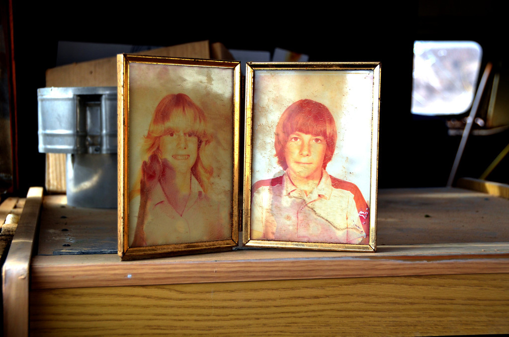 These pictures found in abandoned bus at the site. Leonard's relatives?