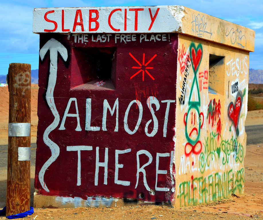 "Often heralded as the ""last free place to live in America"" Slab City is an interesting place to visit. Travlin Bob and I spend a few days talking to residents and exploring and photographing the area.<br /> <br /> ""Slab City or The Slabs (located at 33°15′32″N 115°27′59″W) is a camp in the Colorado Desert in southeastern California, used by recreational vehicle owners and squatters from <br /> across North America. It takes its name from the concrete slabs and pylons that remain from the abandoned World War II Marine barracks Camp Dunlap there. A group of servicemen remained after the base closed, and the place has been inhabited ever since, although the number of residents has declined since the mid 1980s.""<br /> <br /> ""Several thousand campers, many of them retired, use the site during the winter months. These ""snowbirds"" stay only for the winter, before migrating north in the spring to cooler climates. The temperatures during the summer are unforgiving; nonetheless, there is a group of around 150 permanent residents who live in the Slabs all year round. Most of these ""Slabbers"" derive their living by way of government checks (SSI and Social Security) and have been driven to the Slabs through poverty""<br /> <br /> ""The site is both decommissioned and uncontrolled, and there is no charge for parking. The camp has no electricity, no running water or other services. Many campers use generators or solar panels to generate electricity. Supplies can be purchased in nearby Niland, California, located about three miles (5 km) to the southwest of Slab City""<br /> <br /> ""Located just east of State Route 111, the entrance to Slab City is easily recognized by the colorful Salvation Mountain, a small hill approximately three stories high which is entirely covered in acrylic paint, concrete and adobe and festooned with Bible verses. It is an ongoing project of over two decades by permanent resident Leonard Knight.""<br /> <br /> <br /> Slab City a rustic but free-spirited desert colony<br /> Tony Perry, Los Angeles Times<br />  January 1, 2012 <br /> <br />  <a href=""http://www.sfgate.com/cgi-bin/article.cgi?f=/c/a/2011/12/31/MNFI1MDUJN.DTL"">http://www.sfgate.com/cgi-bin/article.cgi?f=/c/a/2011/12/31/MNFI1MDUJN.DTL</a>"