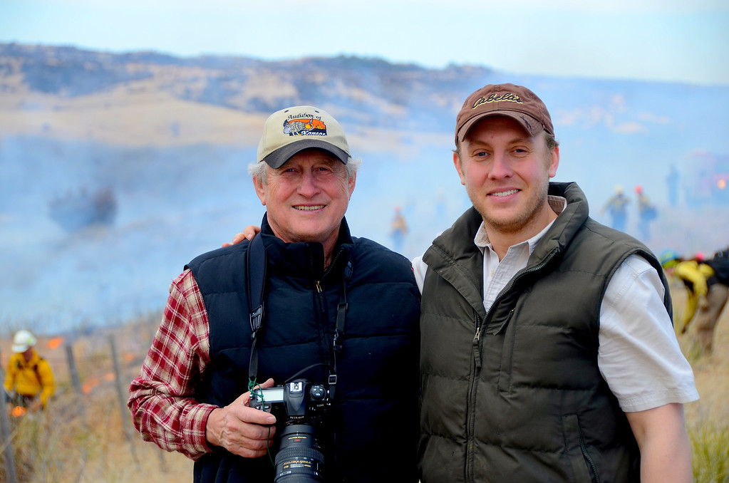 """Ron and his son, Ryan at the controlled burn at the Hutton Niobrara Ranch Sanctuary<br /> <br /> Burning of the pastures is used to control spread of invasive cedar trees and improve the nesting habitat for various ground nesting birds. The Sanctuary uses world class conservation and management strategies for wildlife and its supporting habitat.<br />  <a href=""""http://www.niobrarasanctuary.org/?page_id=33"""">http://www.niobrarasanctuary.org/?page_id=33</a><br /> <br /> <br /> Ryan is a doctoral candidate at Michigan State University and seems destined to helping others and protecting the environment like his father and has aided farmers in Nova Scotia, Mexico, China, Scotland and other far away places. He has also worked with farmers resettling Namibia, Africa. Ryan somehow finds the time to manage the Kansas Audubon website and the website for the Hutton Niobrara Ranch Sanctuary<br /> ."""