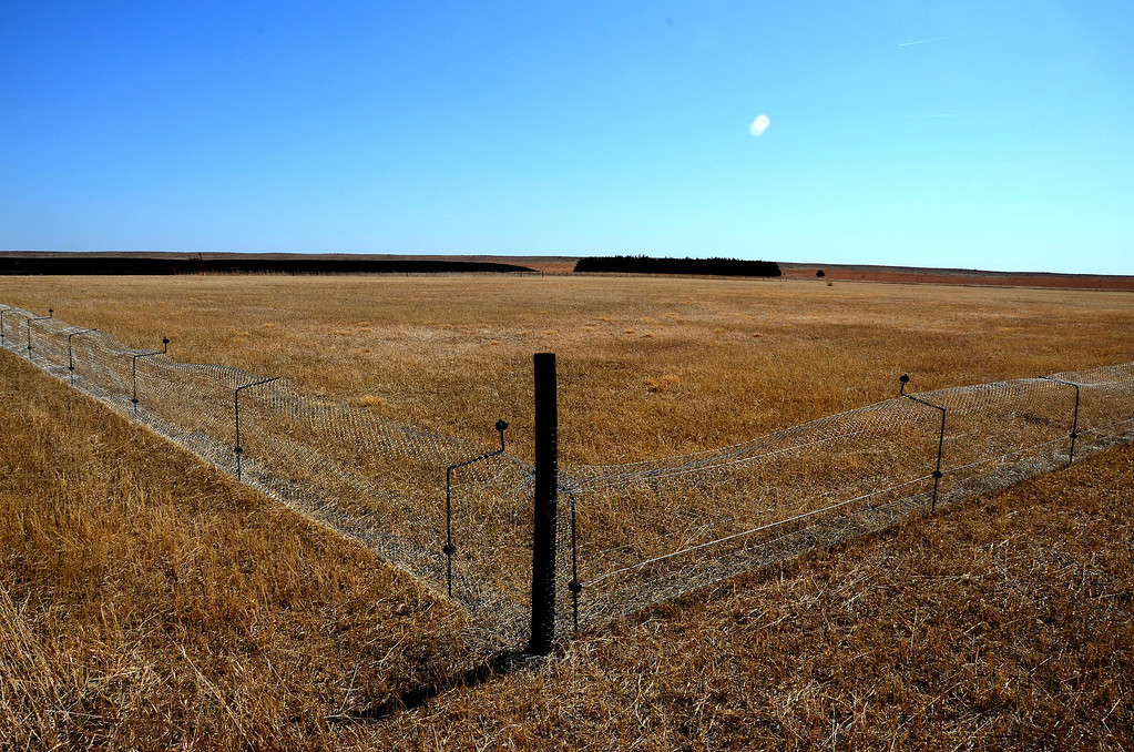 """I called this a SuperMax prison for prairie dogs. A population of 100 prairie dogs will soon move from the Niobrara National Wildlife Refuge to this site in an effort to re-establish residence at the Sanctuary. <br /> <br /> Actually, the fence will be welcomed by the prairie dogs and helps to keep some predators away from them.  Another fence is being considered outside of this fence to keep burrowing badgers away.<br /> <br /> Not too far from this site, Lewis and Clark captured a few prairie dogs to bring back to Thomas Jefferson. The Lewis and Clark expedition is credited with naming prairie dogs and bringing them to the attention of the scientific community.<br /> <br /> Link to article about prairie dog relocation project:<br />  <a href=""""http://www.niobrarasanctuary.org/?p=418#more-418"""">http://www.niobrarasanctuary.org/?p=418#more-418</a>"""