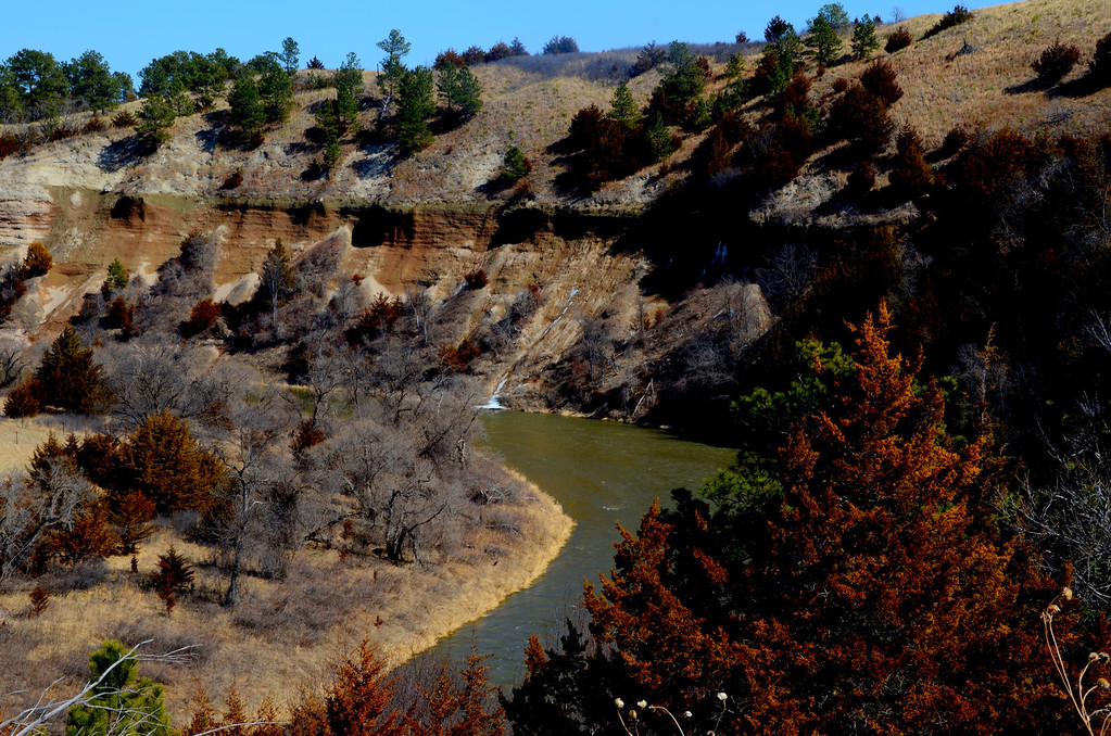 """Water seeps from the cliffs along the Niobrara. A waterfall is also seen emptying into the river.<br /> <br /> National Park Service - Niobrara National Scenic River:<br />  <a href=""""http://www.nps.gov/niob/index.htm"""">http://www.nps.gov/niob/index.htm</a>"""