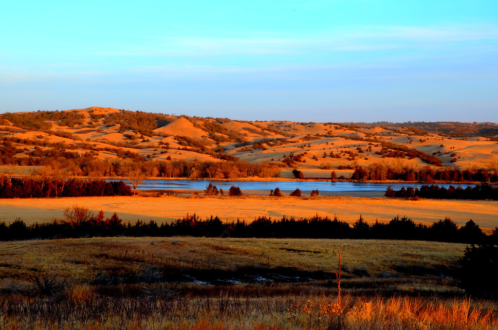 Magic lighting illuminates the Niobrara below my campsite.<br /> <br /> The raucous sounds of meadowlarks, red-winged blackbirds, turkeys, geese, and other birds which I am not skilled enough to identify their calls, awaken me mornings.