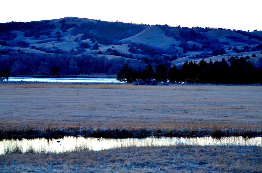 Twilight on the Niobrara. Geese and deer share the meadow below.