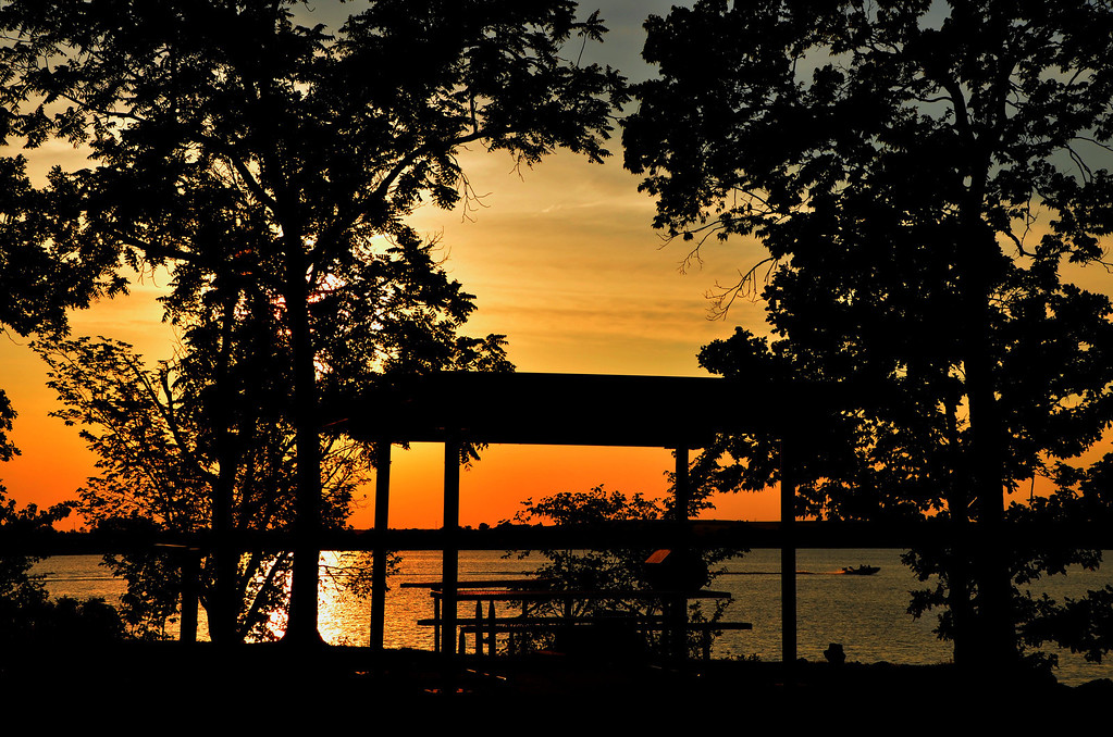 Sunsets overlooking Kansas lakes bring back many memories.