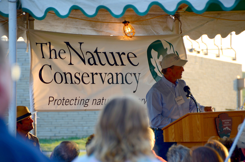 """The Nature Conservancy is the Americas' largest environmental nonprofit by assets and by revenue. The organization owns and controls much of the land dedicated to the Preserve.<br /> <br /> """"On November 12, 1996, Tallgrass Prairie National Preserve (Preserve) was established as a unit of the National Park Service. Congress established the nearly 11,000 acre Preserve as a unique public-private partnership to preserve, protect, and interpret for the public an example of North America's once vast tallgrass prairie ecosystem. The Nature Conservancy is the primary land owner (10,842 acres) with the remaining 34 acres being federal property of the National Park Service, which includes the ranch headquarters area and the Fox Creek one-room schoolhouse.  Through a cooperative agreement between the National Park Service and The Nature Conservancy, co-management of the entire Preserve serves the dual goals of promoting stewardship of park resources while providing public access to the privately owned lands."""""""