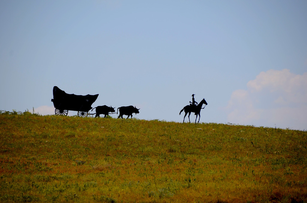 Near Council Grove, I spot these silhouettes on a hill. The Santa Fe Trail once crossed near here. George Armstrong Custer purchased some land near Council Grove after stopping there with the Seventh Cavalry.