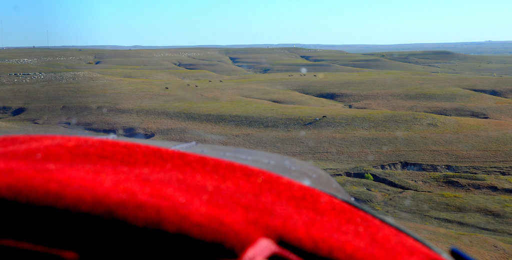 """Aerial approach to Teter Rock from a previous trip. Mustangs are spread out across thousands of acres in the Flint Hills.  Teter Rock is visible high on a distant hill.<br /> <br /> John landing at nearby Otis Creek Reservoir<br />  <a href=""""http://youtu.be/mnlxO7qD2LE"""">http://youtu.be/mnlxO7qD2LE</a>"""