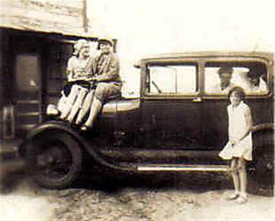 Gail (standing) at Moore's grocery store in Teterville. <br /> <br /> The buildings are all gone now and all that is left is memories to those that lived there in the bustling times of the 1920s, and 30s.
