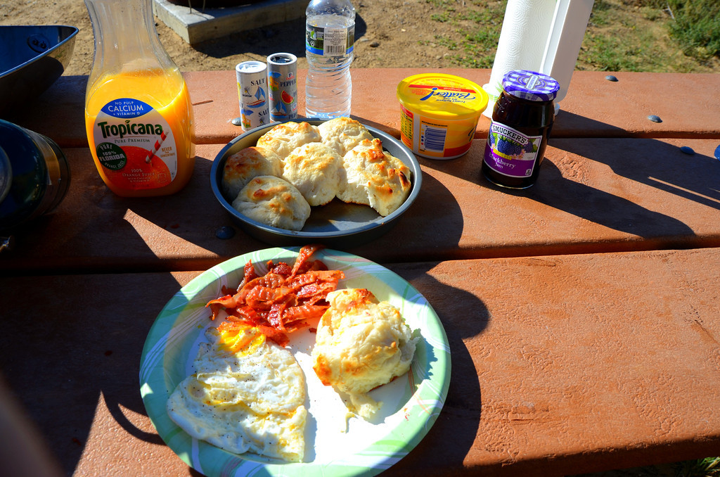 Biscuits cooked in a cake pan on top of my 10 inch square Lodge skillet on my Coleman grill come out  surprising well without scorching the bottom of the biscuits. Cereal with fruit is my normal breakfast when traveling, but a full breakfast every now and then is a real treat when boondocking.