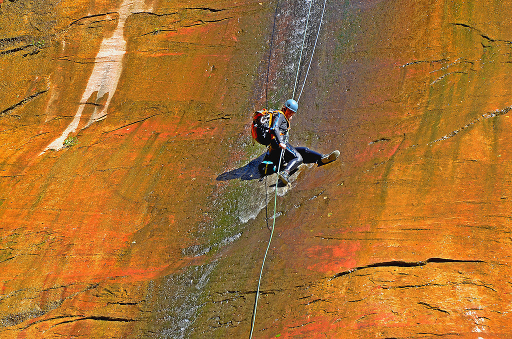 The Narrows <br /> <br /> A couple practice rappelling to the canyon floor against the slippery canyon side. We applaud their arrival.