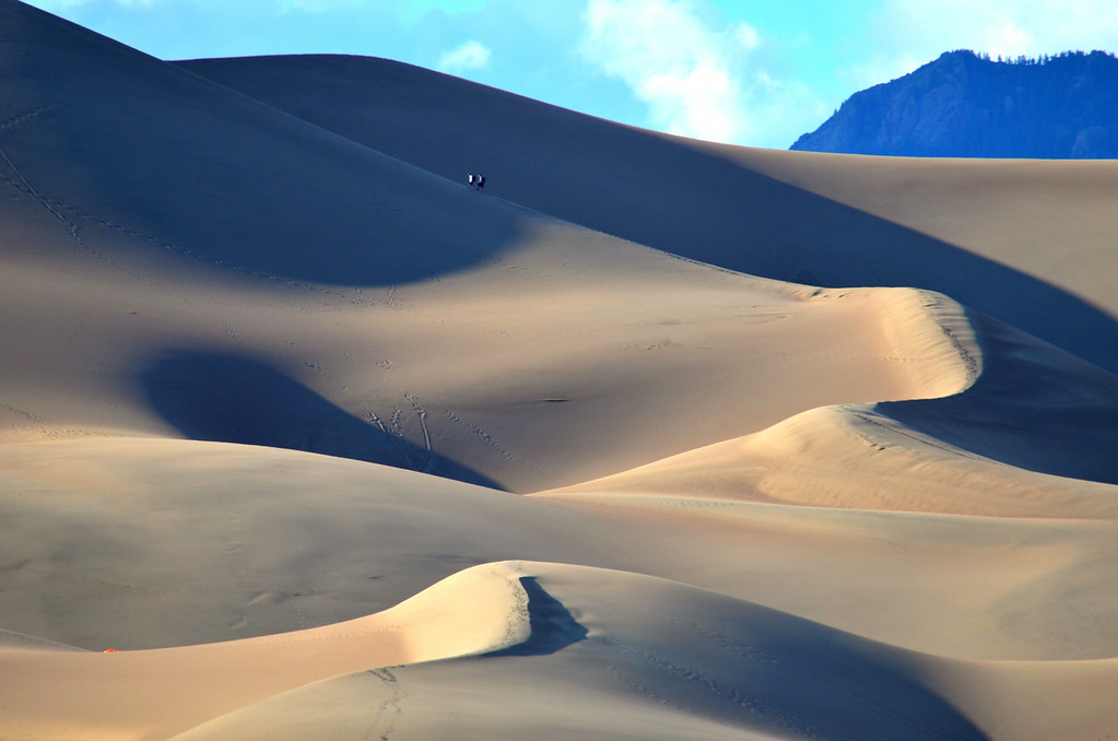 It is a 3 hour hike to the top of the Dunes and back to the parking in the Picnic area. You are advised  to wear shoes as the temperature of the sand can reach 130F degrees.