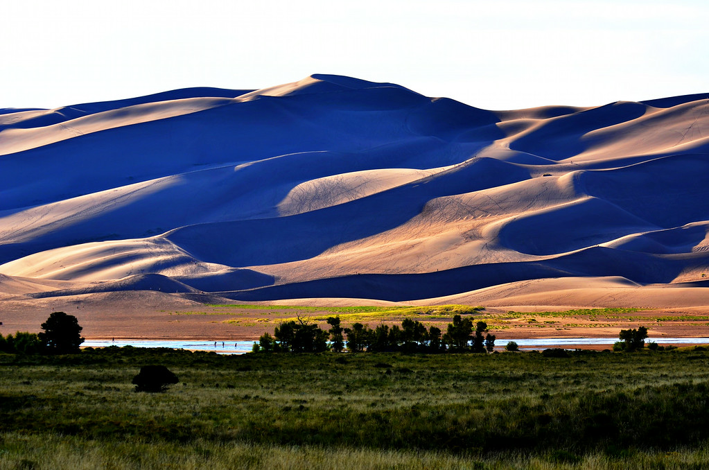 I have yet to visit a National Park and not have it exceed my expectations. Great Sand Dunes National Park offers an amazing diversity of habitat from alpine lakes to the largest sand dunes in the US.<br /> <br /> Medano Creek attracts hundreds of waders daily to its clear, cool waters. Usually dry this time of year, I am fortunate to find it still flowing in August. Peak flows are usually end of May. Hikers climb the dunes up to 750 feet high and slide down them on wood sleds. It is a world class playground for the family.<br /> <br /> At 8,000 ft., the campground is very cool at night with daytime temps in the 80's. I decide to stay three days there to explore more.