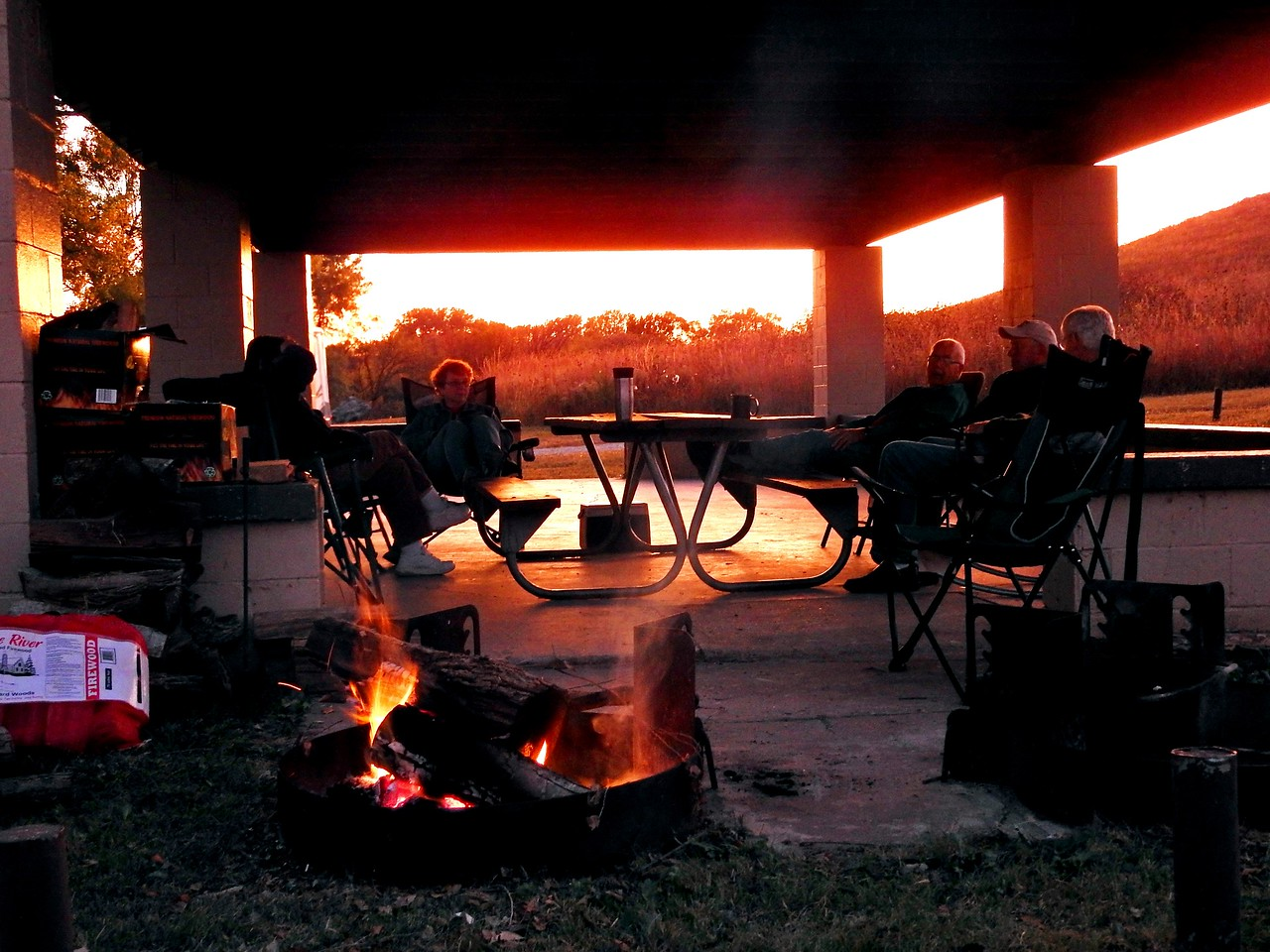 Magic lighting is a prelude to the nighttime campfire ritual.