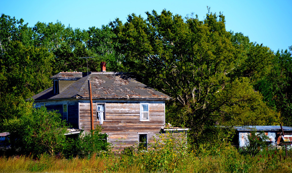 Once a substantial home to a family, this one now stands abandoned like others near Elmdale.