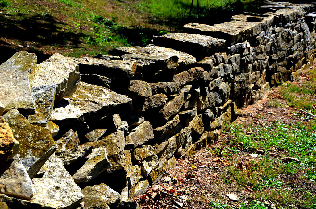 One mile of stone fence fronts the property.