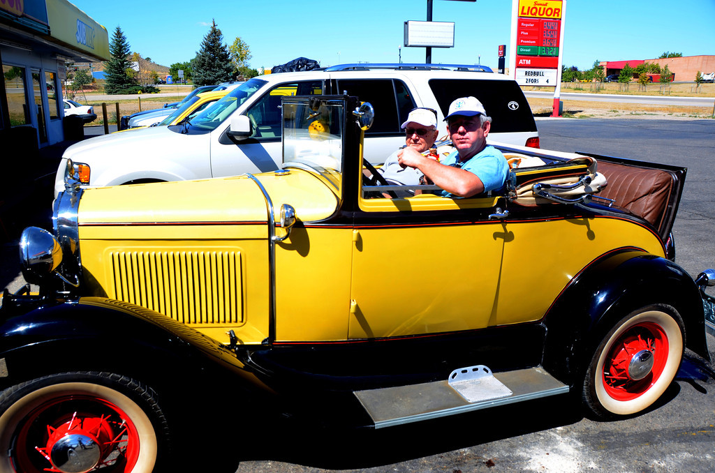 "August 18<br /> <br /> Douglas, Wyoming. A 1932 Ford Cabriolet. I took the picture of the car because it reminded me of my dad.<br /> <br /> My father used to tell a story. As a farm boy he had never left McPherson County, Kansas.  He and a neighbor went to the 1933 World's Fair in Chicago. It was a big adventure for them. One night they stayed in a farmer's field, dad sleeping in the rumble seat. The farmer surprised them in the morning and dad cut hit his head on the seat.<br /> <br /> My dad was buried in a small town cemetery near the farm he was raised at. At the ceremony a tall, aging, but still strong man who I had never met came up to me and put his hand on my shoulder. He asked, "" Did you Dad ever tell you the story about the time we went to the World's Fair and the farmer surprised us?""<br /> <br /> I told him, ""only about a hundred times."""