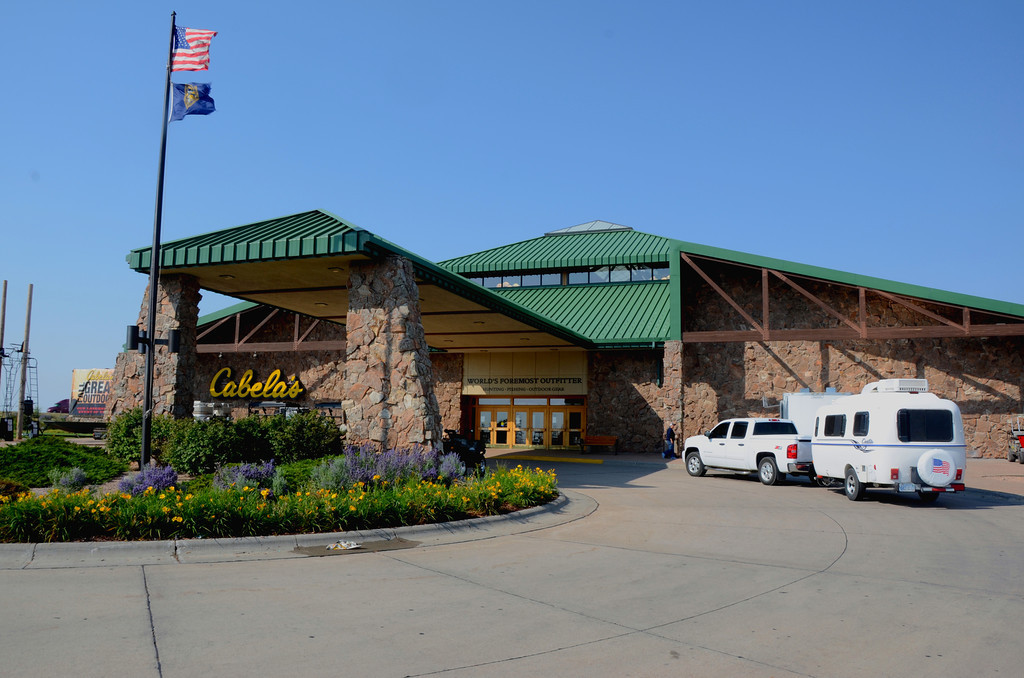 August 16<br /> <br /> I spend the night in Sidney, Nebraska where the mother ship of the Cabela's franchise exists. They have a huge retail store there with a restaurant. It is very well run. An alert manager notices that checkout lines are getting long and reminds one of the clerks to turn on her light for her checkout lane. He also summons another clerk to open up a lane.<br /> <br /> There is a full service RV park next to the store. I elect not to spend the night there to avoid the cost. They also have a large no charge RV parking lot at the store with a dump site. I go by there and pass on it because a refrigerator semi is there with an incredibly loud generator running. <br /> <br /> The Cabela's site in Sidney also includes their own lake with a boat ramp for testing out the boats and their world   distribtuion center.<br /> <br /> A couple from the RV parking lot in a popup stop by to talk to me. Friends of theirs have just purchased a Casita from a man who modifys them in Louisiana. They know all about Casita's from their friends and they hope to purchase their own soon.