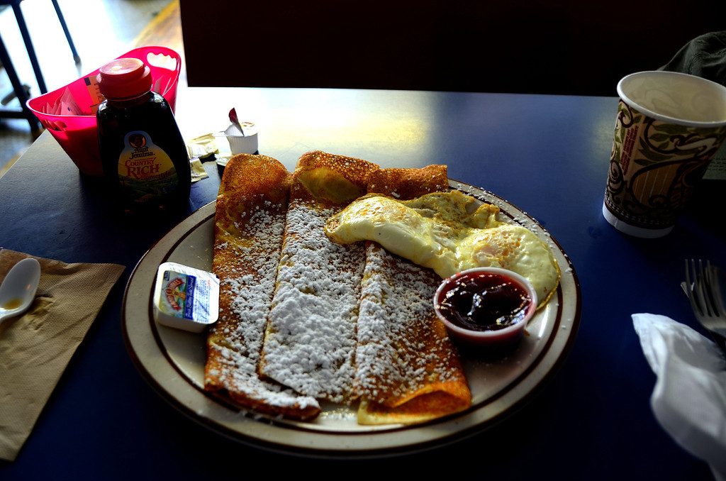 August 14<br /> <br /> I eat a leisurely breakfast at the Sugar Shack in downtown Lindsborg. <br /> <br /> I try the Swedish pancakes with imported ligonberries for the first time  They were delicious. <br /> <br /> I purchase some of the dry mix to use along my journey.