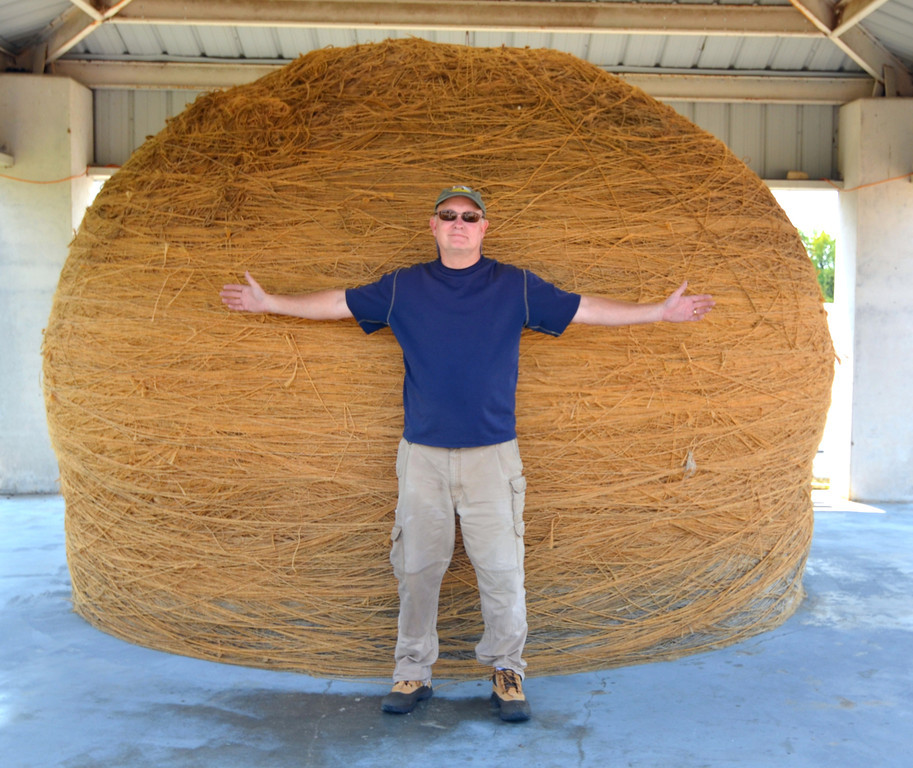 "August 15<br /> <br /> Cawker City is the site of  ""World's Largest Ball Of Twine"". <br /> <br /> Okay, it is not high on my bucket list but at least I can say I have seen it now.<br /> <br /> I visit with a young couple from Kansas City by the Twine and take their picture with their camera. <br /> We record our names and home city in the journal there and read the funny comments.<br /> <br /> I am following the blog of my friend Horst Kelly, who is currently in Glacier National Park posting pictures of the Many Glacier and Logan Pass areas in the Park. I leave a post on his blog telling him there he is photographing places as close to heaven on earth as you can get and I am posting pictures of the ""World's Largest Ball of Twine""."