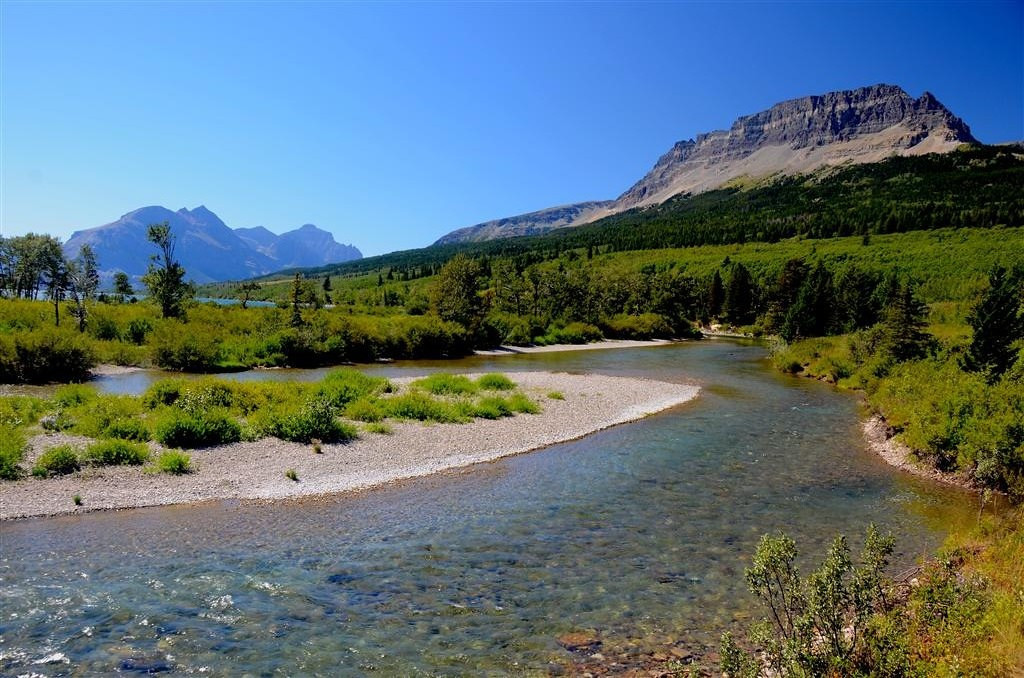 August 25<br /> <br /> I awaken to a perfect day in Glacier. The now familiar Saint Mary River scene is changed with no clouds in the background. <br /> <br /> Today, I will further explore the East Side of Going to the Sun Highway