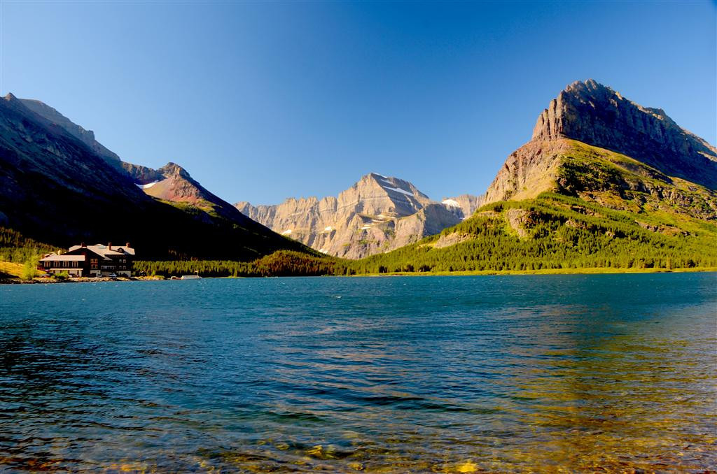 August 30<br /> <br /> Nice cooling breeze on Swiftcurrent Lake.  I never tire of this scene.