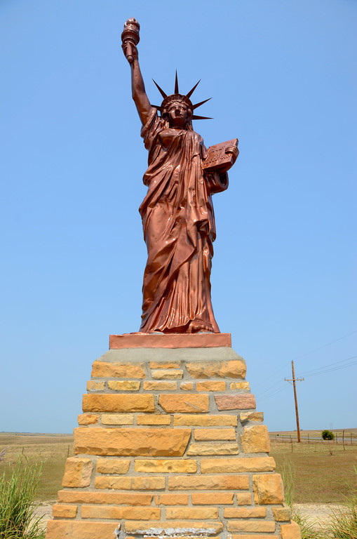 """August 15<br /> <br /> I travel along a """"blue highway"""" that overlooks the Solomon River valley. It is rich farmland and the farmers appear to be prosperous along the way. <br /> <br />  As I travel the rural area, I drive by a large Statue of Liberty. The site is not marked by any signage and I am curious. I turn my rig around to visit the statue. I always thought the statue was in New York City."""